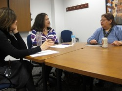 Group members discuss future plans in a meeting at Marquette University. (Photo by Courtney Perry)