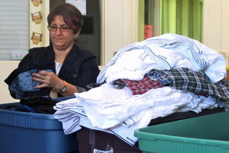 Executive Director Cindy Krahenbuhl sorts underwear donated to the Guest House at a recent event. (Photo by Brynne Ramella)