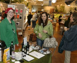 Fair Trade Crawl 2012 participants enjoy wine and chocolate samples at Outpost Natural Foods.  Photo by Steve Watrous.