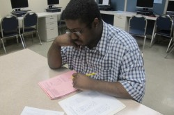 Garry Davis studies for the math portion of the GED test at the YWCA. (Photo by Edgar Mendez)