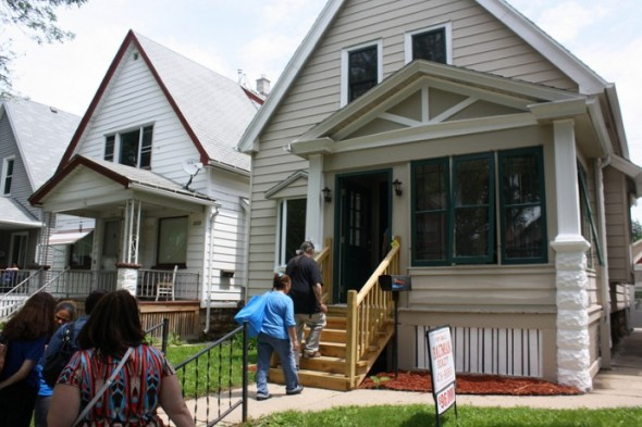 Attendees enter the sixth and final home on the tour, a single-family house at 2026 S. 29th Ave. (Photo by Maggie Quick)