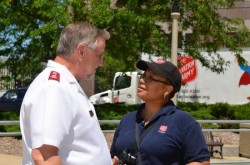 Roger Ross, commander of the Salvation Army of Milwaukee County, and Faithe Colas, community relations director, chat at the Feed the Children kickoff event. (Photo by Sue Vliet)