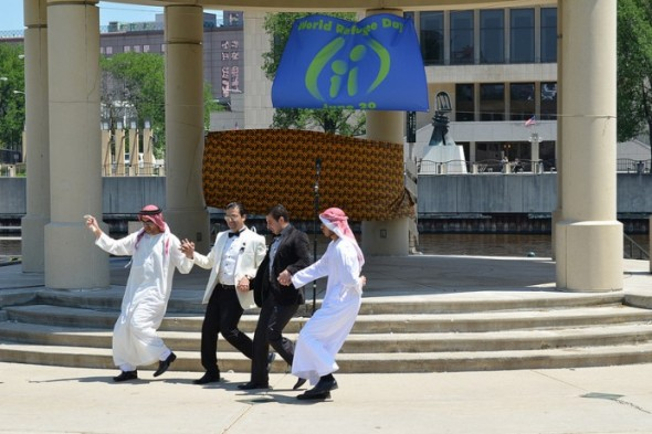 Iraqi refugees demonstrate a native dance at World Refugee Day. (Photo by Sue Vilet)