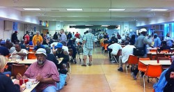 Guests enjoy dinner at St. Ben's during the church's community meal held six days a week. (Photo by Brendan O'Brien)