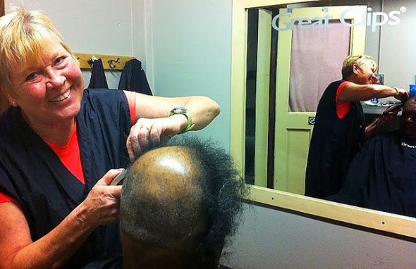 Hairstylist Judy Kinney gives a haircut to Josh Tucker, 67, at St. Benedict the Moor. (Photo by Brendan O'Brien)