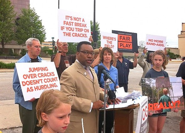 Rev. Carl Griffin speaks during event to unveil report on athletic and recreational facilities at Milwaukee County public schools. (Photo by Brendan O'Brien)