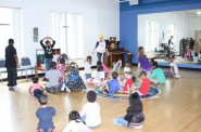 "Julia Magnasco from First Stage leads an interactive storytelling workshop for children entitled ""When I Grow Up."" (Photo courtesy of COA Youth & Family Centers) - See more at: http://www.milwaukeenns.org/2013/06/12/first-ever-coa-family-literacy-summit-shines-light-on-literacy/?pcat=211#sthash.CyEBf3rS.dpuf"