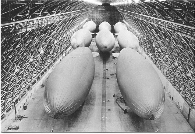 Eight massive blimps ready to take the air to search for Japanese submarines during World War II.