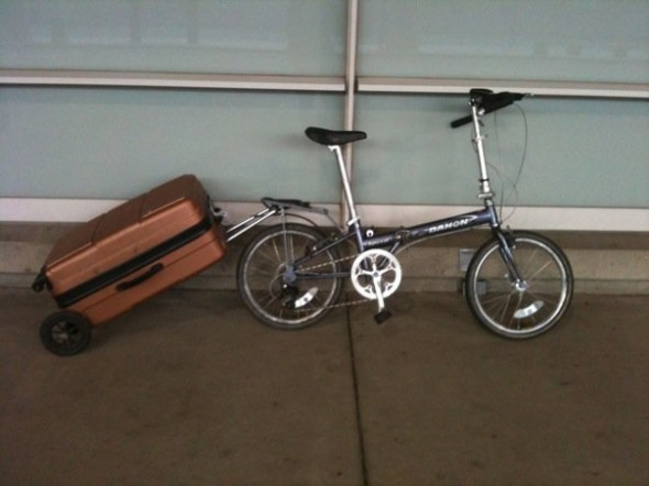 My Dahon and the DIY trailer (my carry-on suitcase is inside it) outside the Mitchell Field.