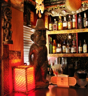Front bar at Foundation featuring tiki statue. Photo by Nastassia Putz.