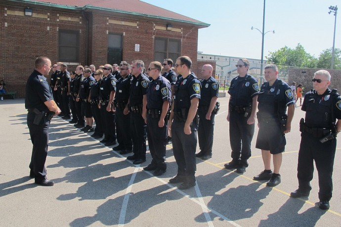 Officers from the 5th District stand at attention during the roll call. (Photo by Edgar Mendez)