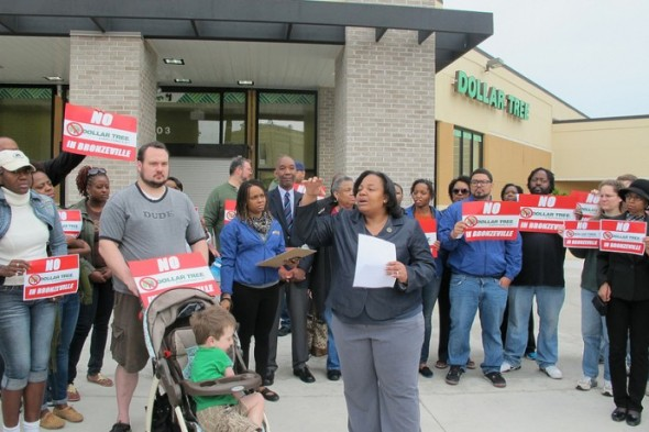 Alderwoman Milele Coggs leads an opposition rally outside of the Dollar Tree on King Drive and North Avenue in June. (Photo by Shakara Robinson)