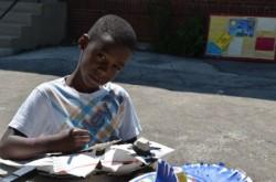 Devon Thompson-Randall, 7, works on his fish. (Photo by Sue Vliet)