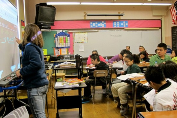 A teacher at the Greenfield School provides classroom instruction to students. (Photo by Tessa Fox)