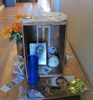 An ofrenda (altar) created in JJ's honor features Packers tickets, chocolates and a deck of poker cards, among other items. (Photo by Edgar Mendez)