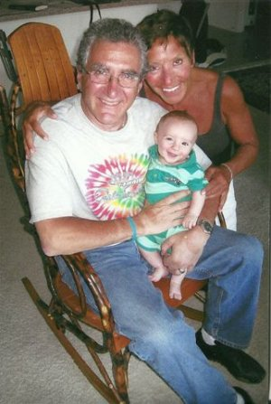 Bruce, Judy, and their grandson.