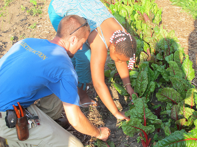 Shavez Boster, 10, learns the basics of gardening from Walnut Way's Jeremy Davis. (Photo by Shakara Robinson)