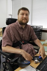 Nick Zouski, a caseworker at Access to Independence, says the need for state Division of Vocational Rehabilitation services is growing, and it is hard for clients to wait indefinitely for help. Kate Golden/Wisconsin Center for Investigative Journalism