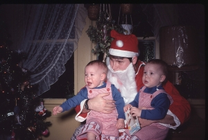 The twins with dad during their first Christmas, 1978.