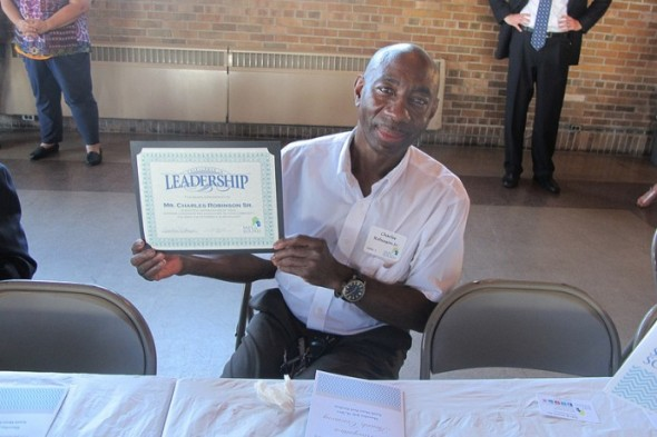 Charles Robinson Sr. of Borchert Field, says organizing neighbors and linking young and older residents is the key to revitalizing neighborhoods. (Photo by Edgar Mendez)