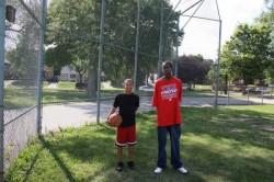Fernando Langford, left, and Bontae Payne throw basketballs around the baseball diamond in Sherman Park. (Photo by Maggie Quick)
