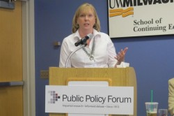 Anneliese Dickman addresses several hundred participants at a recent conference sponsored by the Public Policy Forum. (Photo by Edgar Mendez)