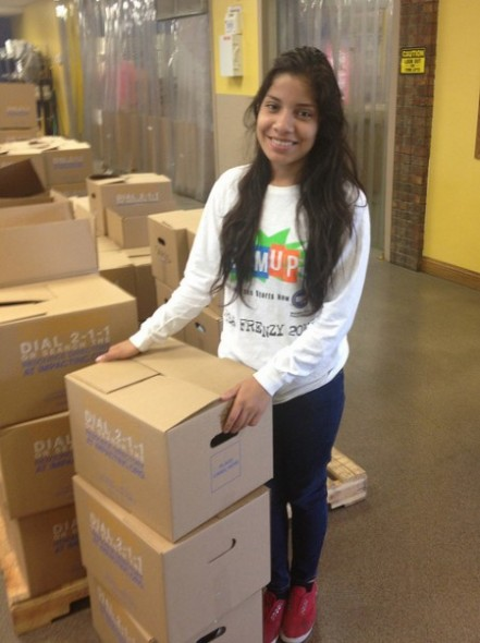 A student volunteers, helping sort food at the Hunger task Force. (Photo Courtesy of Milwaukee Public Schools)