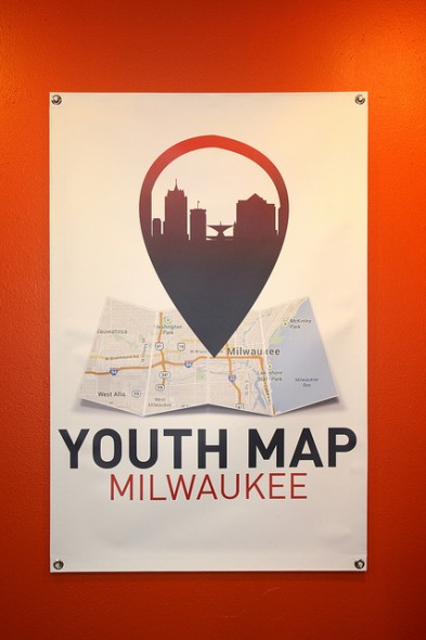 A Youth Map Milwaukee poster located in the Center for Youth Engagement. The initiative is looking for more student volunteers. (Photo by Maggie Quick)