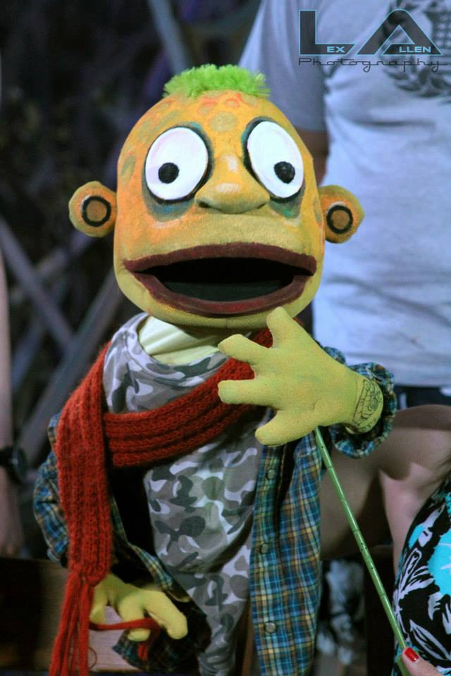 "Aaron Bradway, the lead character in ""The Burden of Being,"" is one of several monster characters in the play, portrayed by puppets."