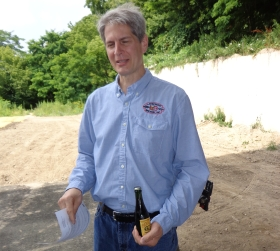 Russ Klisch holds a 15-year old bottle of Lakefront Brewery Beer Line Barley Line, produced back when his brewery was located on E. Chambers St. Photo by Michael Horne.