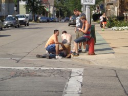 Citizens subdue a disorderly person.