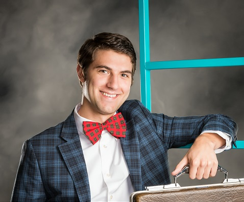 """Jake Konrath as J. Pierpont Finch in """"How to Succeed in Business Without Really Trying."""" Photo courtesy of the Sunset Playhouse."""