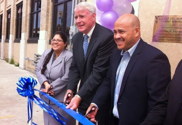 Executive director Patricia Ruiz-Cantu cuts the ribbon with Mayor Tom Barrett and Jose Perez during an event celebrating the opening of La Luz del Mundo Family Services violence prevention center. (Photo by Brendan O'Brien)