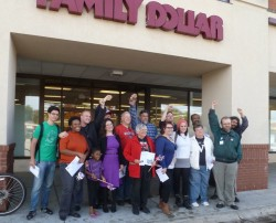 Protesters pose for a group photograph after staging a protest at Family Dollar. Bill Lueders/Wisconsin Center for Investigative Journalism