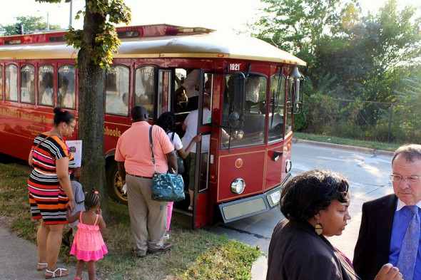 Participants board the trolley, as Alderwoman Milele Coggs and Rocky Marcous, commissioner of the Milwaukee Department of City Development, talk over the tour. (Photo by Mark Doremus)