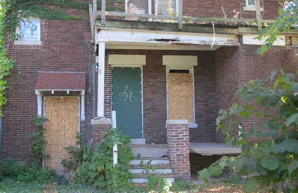 Boarded-up houses drag down property values in Milwaukee neighborhoods. (Photo by Scottie Lee Meyers)