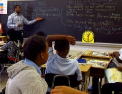 General Education Teacher Bryson Green of Teach for America leads his fifth-grade students in a discussion about stereotypes at Carver Academy. (Photo by Rick Brown)