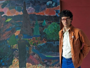 Nicholas Frank in front of a painting by Tom Uttech. Photo by Tara Bogart.