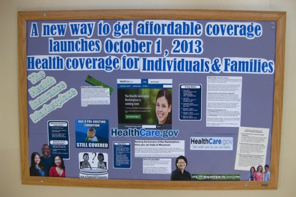 The Lisbon Avenue Health Center informed patients of open enrollment before Oct. 1 via mailings and a bulletin board in the waiting room. (Photo by Rick Brown)