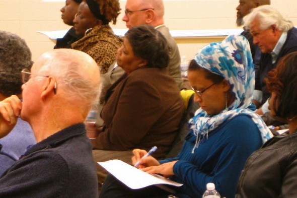 Sherman Park resident Sakeena Jawad (right) takes notes as panelists update the community on the Lindsay Heights Quality of Life Plan. (Photo by Rick Brown)