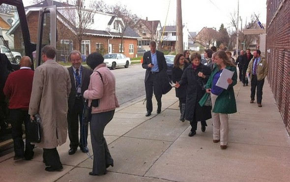 Harambee neighborhood tour participants get back on the bus after viewing the Riverworks Lofts. (Photo by Brendan O'Brien)