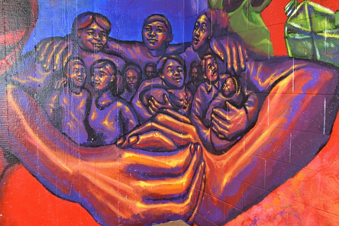 A mural at Neighborhood House of Milwaukee captures the spirit of the settlement house. (Photo by Sue Vliet)