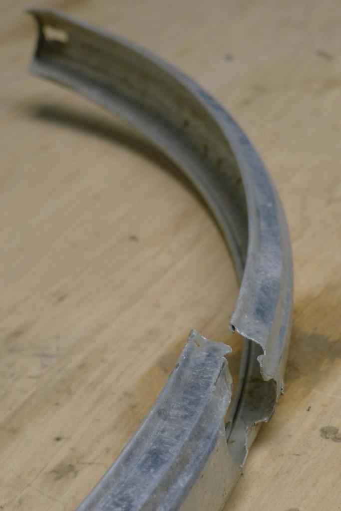 The crack near where the rear fenders attach to the brake bridge.