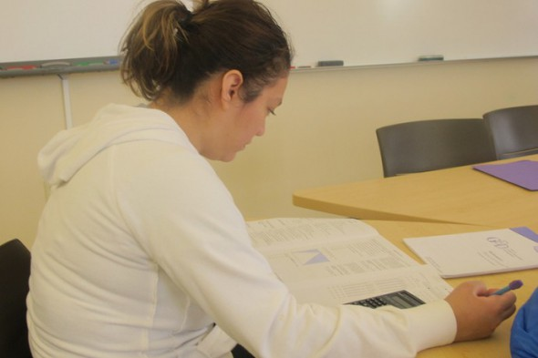 Blanca Rodriguez studies for her math exam. (Photo by Edgar Mendez)