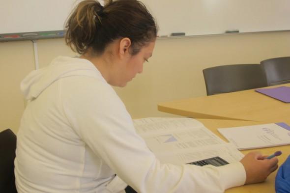 Blanca Rodriguez studies for her math exam. (Photo by Edgar Mendez)