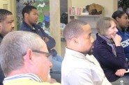 Participants listen attentively as speakers discuss community concerns. (Photo by Andrea Waxman)