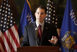 Wisconsin Gov. Scott Walker at a Nov. 14, 2013, press conference where he announced his plan to delay the changes to BadgerCare eligibility. The changes will take effect on April 1, 2014, three months after then originally set date, Jan. 1, 2014. M.P. King/Wisconsin State Journal