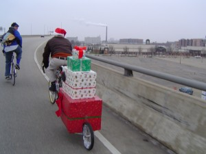 There were not as many full red suits, but even on the early rides Santas were creative. The presents in the B.O.B trailer are a sound system.