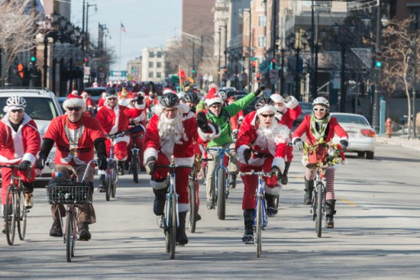 More than 100 West Side Santas head down Wisconsin Avenue to rendezvous with the other Santas at Lakefront Brewery.