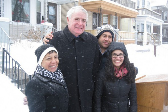 Milwaukee Mayor Tom Barrett shares a laugh with homeowner Marisela Martin, 12th District Alderman José Pérez and Maritza Martin after a press conference on the 1800 block of West Arthur Avenue. (Photo by Brendan O'Brien)